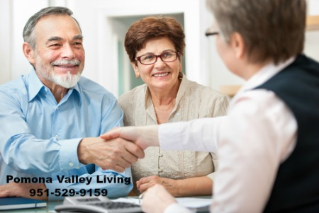 Older couple shaking hands with agent